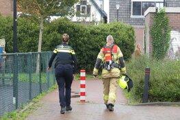 Afval in brand gestoken achter woonhuis in Schagen